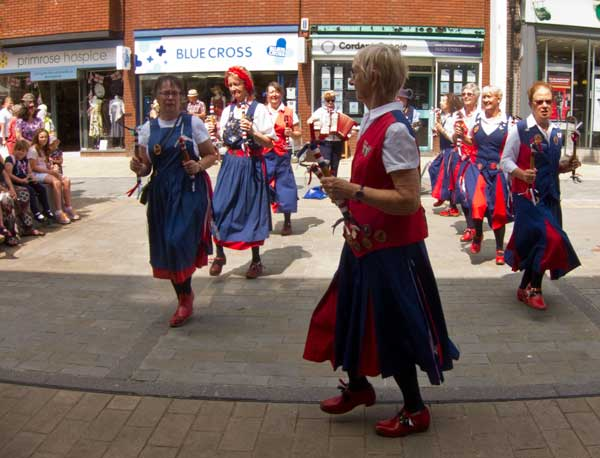 dancing in the busy high street in Bromsgrove