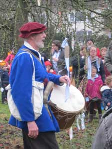 man in mediaeval costume leading the Wassail at Avoncroft with a drum