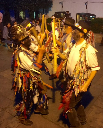 Alvechurch Morris dancers in action with sticks at the ready