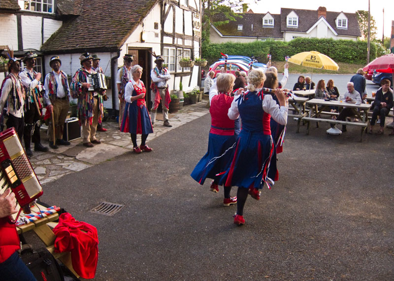 Dancing in front of the timber framed Old Bull, home of the 'Archers'