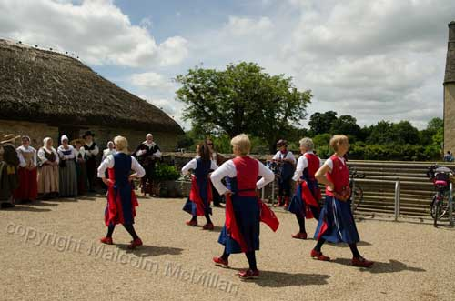 Dancing at Coggs Manor Farm Witney in front of impressive thatched building